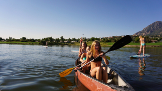 Girls in canoe and standup paddle board