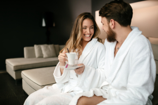 Couple in spa robes drinking tea