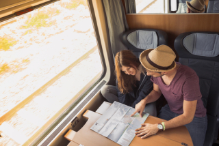 Couple looking at map on train